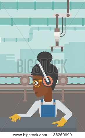 An african-american woman working on metal press machine. Worker in headphones operating metal press machine at workshop. Woman using press machine. Vector flat design illustration. Vertical layout.