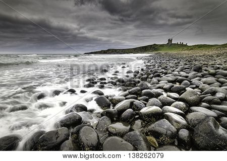 Dunstanburgh Castle on the coast of Northumberland in northern England