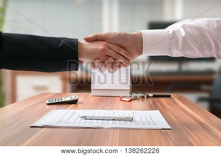 Shakehand Of Lawyer And Business Woman Sitting Behind Desk With