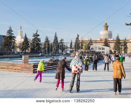 Moscow - November 28 2015: Many people have a rest and ice-skating on the large outdoor skating rink in winter park beautiful ENEA 2016 November 28 2015 Moscow Russia