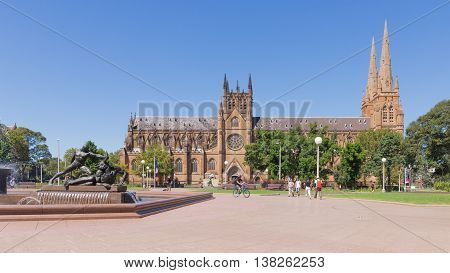 Sydney - February 25 2016: Beautiful gothic Catholic Cathedral of St. Mary Archibald Fountain and Hyde Park in fine clear weather February 25 2016 Sydney Australia