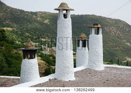 Detailed view of traditional chimneys in Capileira, Alpujarra, Granada province, Andalusia, Spain