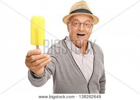 Joyful senior man holding a yellow popsicle isolated on white background