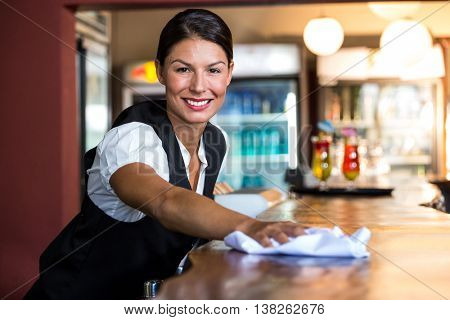Waitress cleaning the counter in a restaurant