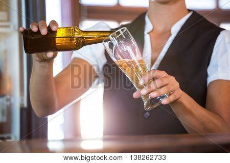Waitress preparing a beer in a restaurant