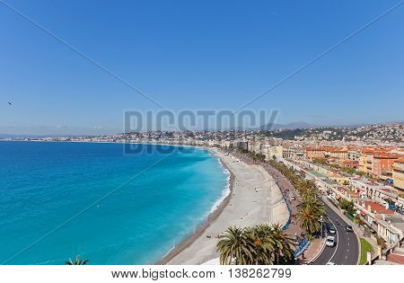 View of the beach and esplanade in Nice France from Bellanda Tower of Castle Hill. Nice (Nicaea) was probably founded around 350 BC by the Greeks of Massilia