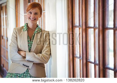 Woman standing with arms crossed in a restaurant