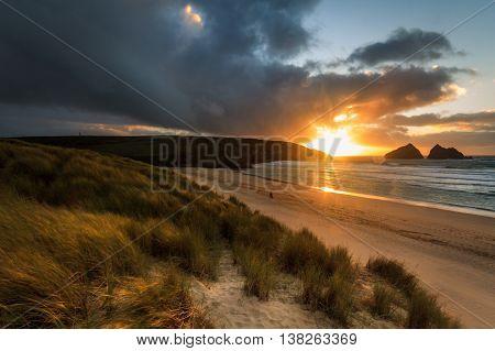 sunset over Holywell Bay Beach Cornwall England UK