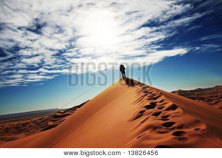 Man go up in sand desert
