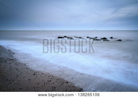 Long exposure shot on a beach Tranquil waters.