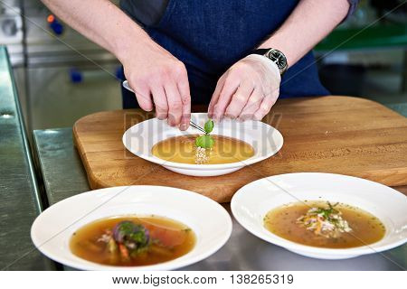 Preparing Dishes - Vegetable Soup On Restaurant Kitchen