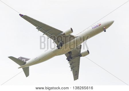 CHIANG MAI THAILAND - 12 JULY 2016 - Thai Airways aircraft flies in for landing at Chiang Mai International Airport on 12 July 2016