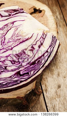 red cabbage on wooden background close up