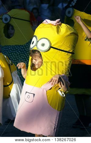 Montenegro, Herceg Novi - 04/06/2016: Little girl in a fancy suit minion. 10 International Children's Carnival