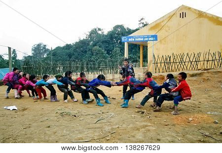 LAO CAI, VIETNAM, February 14, 2016 Children's groups, playing tug of war in ethnic Hmong, Lao Cai highland, Vietnam, entertainment