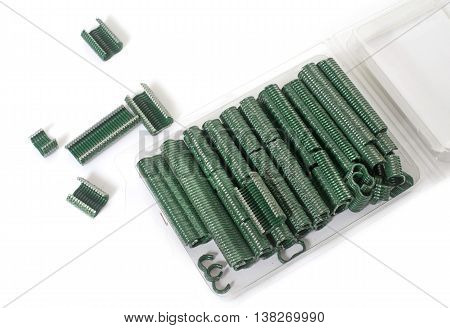 staples for wire fence in front of white background