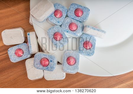Detergent For Cleaning Dishes. Dishwasher Tablets And Clean Plat