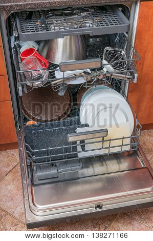 Dishwasher In Kitchen Full With Dirty Dishes.