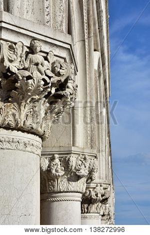 Doge Palace ancient medieval capitals and columns with allegoric reliefs in Saint Mark Square Venice