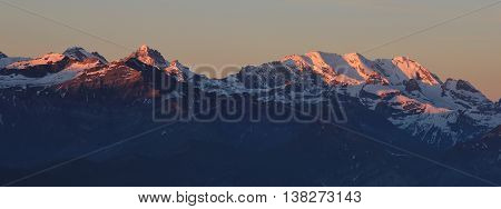 High mountains in the Bernese Oberland at sunrise. View from Mt Niederhorn Beatenberg. Bluemlisalp.