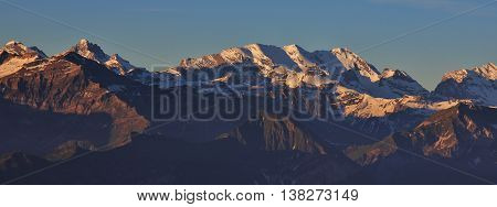 High mountains in the Bernese Oberland at sunrise. View from Mt Niederhorn.