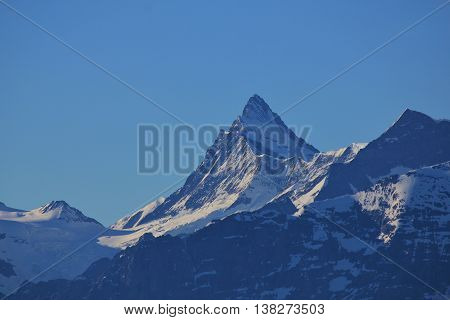 High mountain in the Swiss Alps. Mt Finsteraarhorn. Nature background.