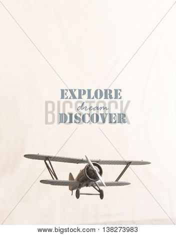 explore, dream, discover - text and retro plane