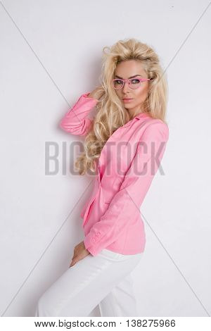 Beautiful Lush Blond Curly Hair Sexy Model With Green Eyes In Glasses In The Pink Elegant Jacket, Su