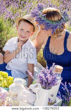 Happy little boy with his mother in a lavender field