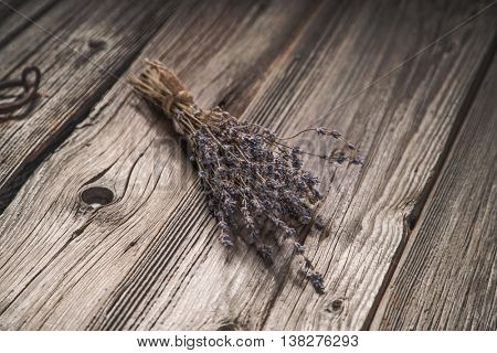 Dried lavender bouquet on grungy wooden background, vintage tone