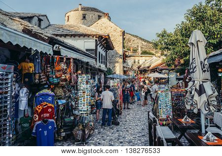 Mostar Bosnia and Herzegovina - August 25 2015. Paople walks among souvenirs shops on the Old Town of Mostar