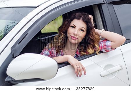 beautiful driver woman smiling looking out the window