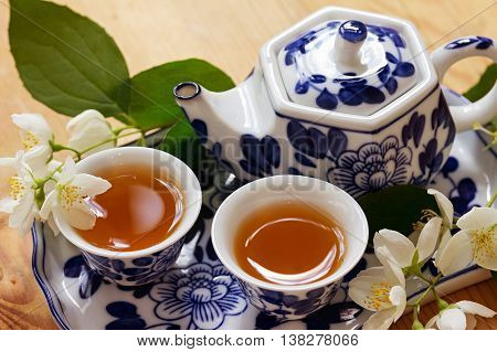 Jasmine green tea and jasmine flowers. Still life: Tea set