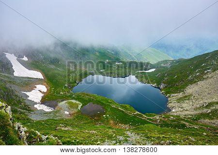 Landscape with lake Capra in Romanian Carpathian mountains