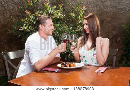 Young Couple On Date Toasting With Wine