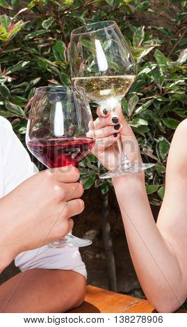 Close-up Of Man And Woman Toasting Wine Glasses