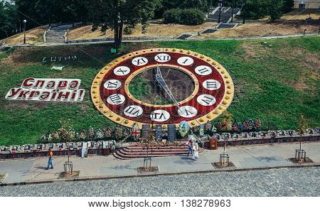 Kiev Ukraine - July 26 2015. Floral clock and Memorial for killed Euromaidan participants at Heroes of Heavenly Hundred Alley