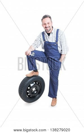 Confident Young Engineer Standing Near Car Wheel