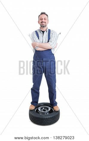 Happy Mechanic With Positive Attitude Standing On Wheel