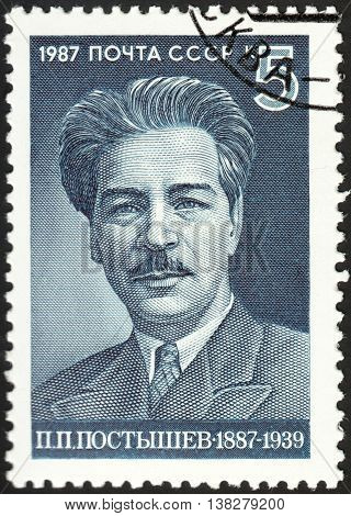 MOSCOW RUSSIA - DECEMBER 2015: a post stamp printed in the USSR shows a portrait of P.P.Postyshev devoted to The 100th Anniversary of the Birth of P.P.Postyshev circa 1987