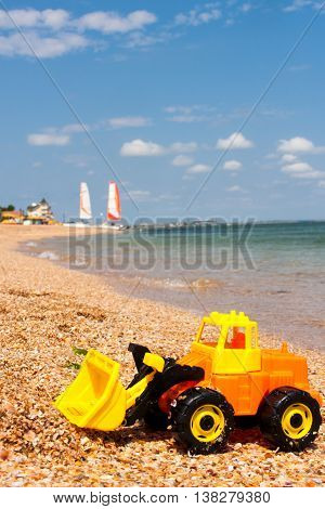 children's toys on the beach on a sunny day.