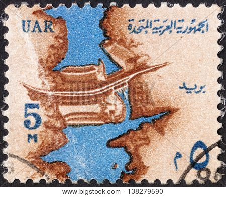 MOSCOW RUSSIA - JANUARY 2016: a post stamp printed in United Arab Republic (UAR) shows the Nile River and Aswan High Dam the series
