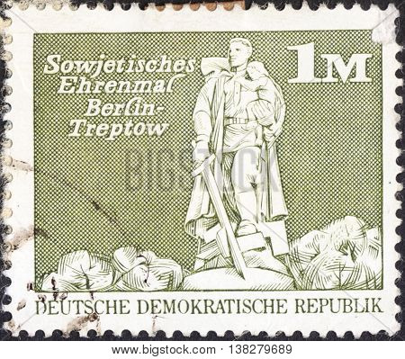 MOSCOW RUSSIA - JANUARY 2016: a post stamp printed in DDR shows the Soviet War Memorial Treptow Berlin the series