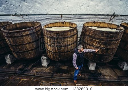 Pilsen Czech Republic - October 3 2015. Guide shows old wooden barrels in cellars of Pilsner Urquell Brewery