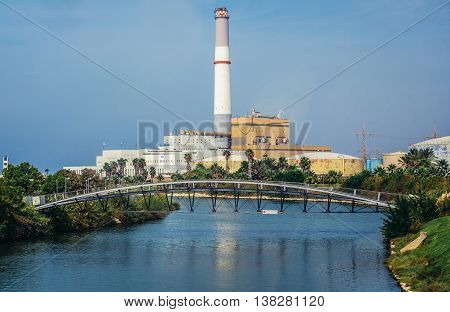 Tel Aviv Israel - October 18 2015. View of a chimney and buildings of Reading Power Station in Tel Aviv