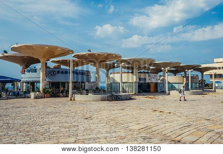 Tel Aviv Israel - October 18 2015. Buildings at Atarim Square also known as Namir Square designed by architect Yaakov Rechter
