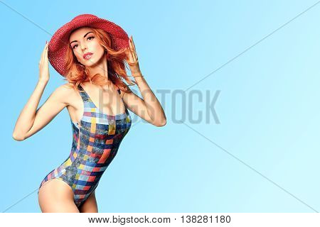 Fashion. PinUp woman in fashion Beach swimsuit. Playful Sexy Redhead Model girl in Summer Stylish Outfit, Hat. Beach body, sexy Trendy beach swimsuit, Pinup fashion. Summer holiday, Unusual Creative