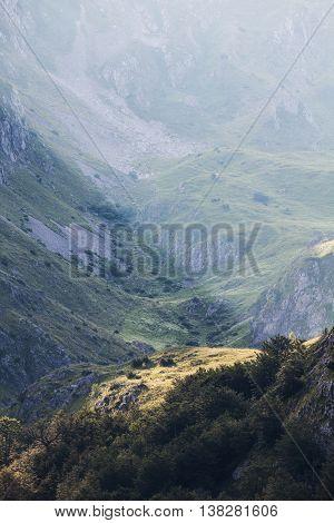 Sunbeam on cliff in mountain, Dinaric Alps, Europe.