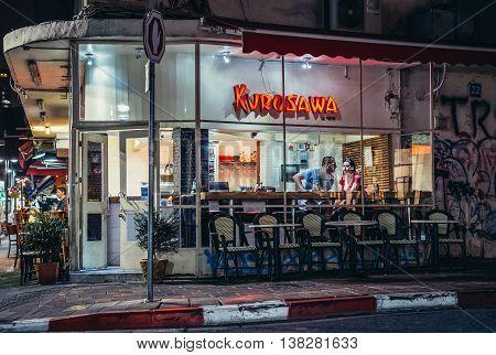 Tel Aviv Israel - October 19 2015. Couple sits in sushi restaurant in Tel Aviv