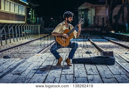 Tel Aviv Israel - October 19 2015. Man plays guitar on the site of renovated former Jaffa Railway Station completed in 1891 and closed in 1948